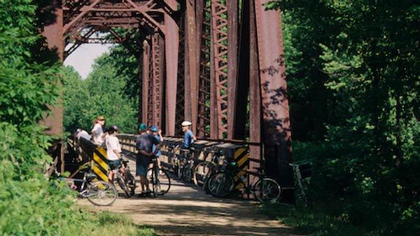 Biking on Bridge by RJ & Linda Miller