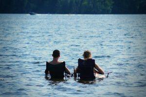 ONE people sitting in lake (Linda Finger)